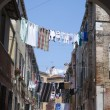 Royalty-Free Stock Photo: Linens and clothes dries outdoor. Venice street, Italy