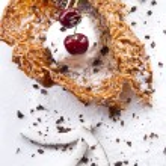 Coconut ice cream and cherry — Stock Photo #6900705