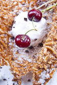 Coconut ice cream and cherry — Stock Photo