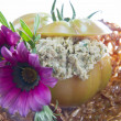 Stuffed tomato with greens - Stock Photo