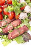 Fresh bresaola rolls and mousse with vegetables — Stock Photo