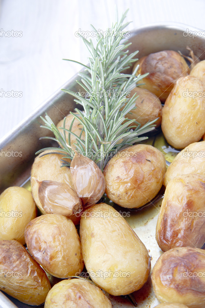 Baked Potatoes with rosemary  — Stock Photo #6969456