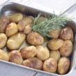 Baked Potatoes with rosemary — Stock Photo