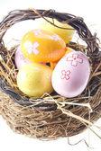 Easter Eggs in bast basket — Stock Photo