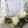 Stock Photo: Blank photo frame and white roses