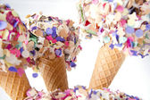 Party food sweet icecream cones with confetti decoration — Stock Photo