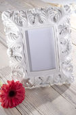 Blank photo frame and flower — Stock Photo