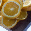 Slices of lemon on chopping board - Lizenzfreies Foto