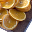 Slices of lemon on chopping board - Stockfoto