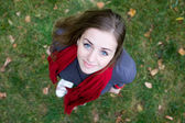 Beautiful young brunette girl in red scarf. Top view — Foto de Stock
