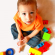 Baby plays with many-coloured toys — Stock Photo