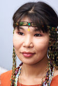 Portrait of young beautiful chukchi woman in folk dress — Stock Photo