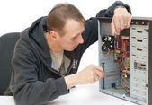 Technician repairing PC isolated on white — Stock Photo