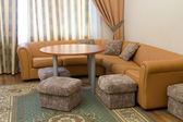 Sofa and round table in the suite — Stock Photo