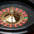 Roulette wheel (casino attribute) close up — Stock Photo #7372086