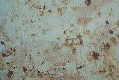 Painted metal surface with rusty spots — Stock Photo