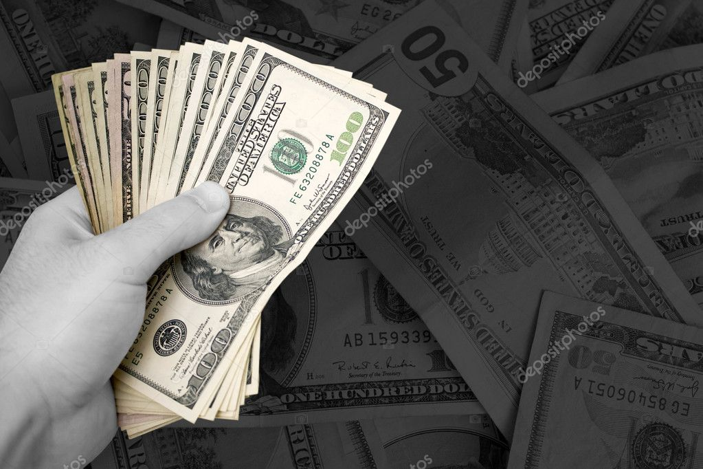 A handful of cash.  The money has selective color, and the rest of the image is in black and white - plenty of copy space. — Stock Photo #6804013