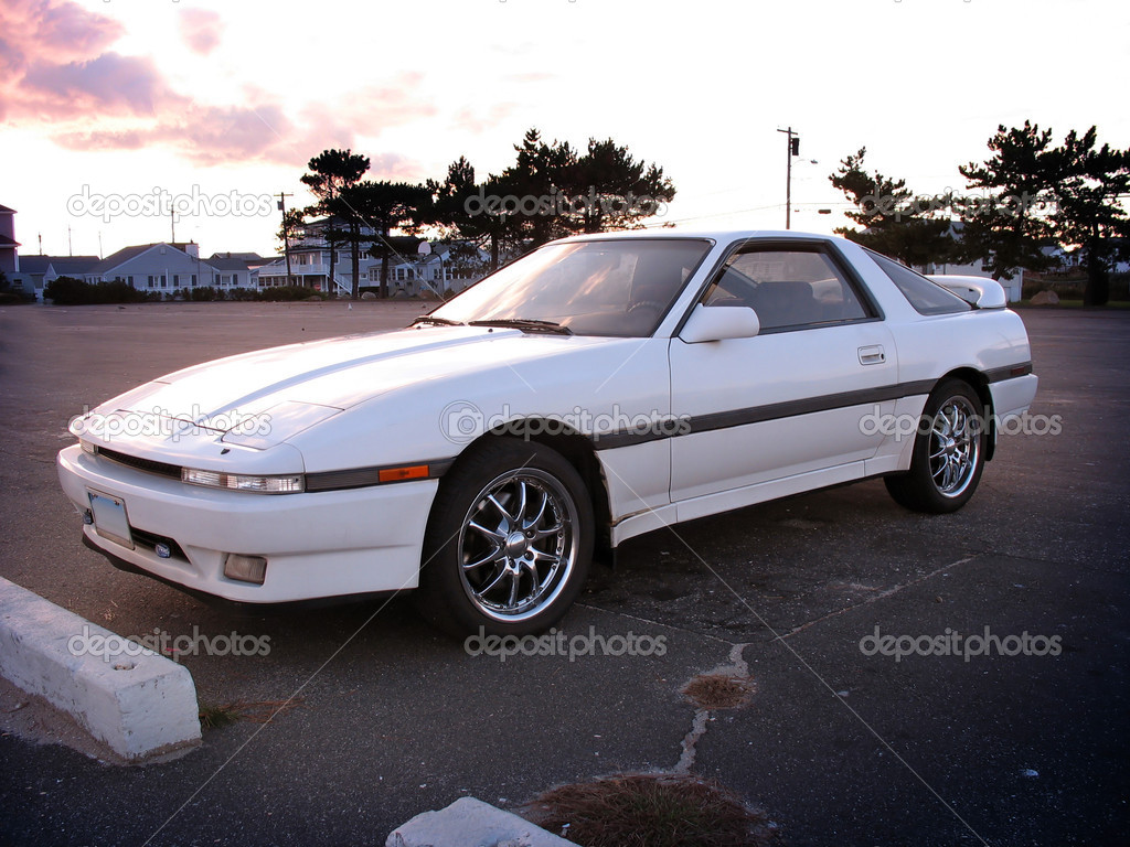 A customized white sports car parked at the beach. — Stock Photo #6804033