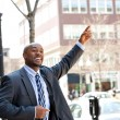 Business Man Hails a Taxi - Stock Photo