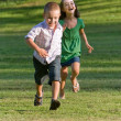 Two Young Children Running and Playing — Stock Photo