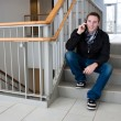Man Talking on His Cell Phone in the Stairwell — Stock Photo