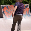 Stock Photo: Skateboarder Skating at Skate Park