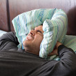 Man Having Trouble Sleeping - Stock Photo