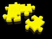 Puzzle, yellow color. Isolated on black — Stock Photo