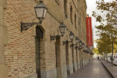 Streetlights and brick facade, History Museum of Catalonia, Spain — Stock Photo