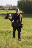 Falconer with raptor — Stock Photo