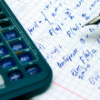 Home work, calculation with pen and calculator — Stock Photo