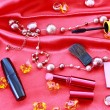 Many cosmetics on red background — Stock Photo #6779415