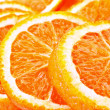 Many sliced oranges — Stock Photo
