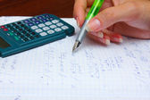 Home work, calculation with pen and calculator — Stok fotoğraf