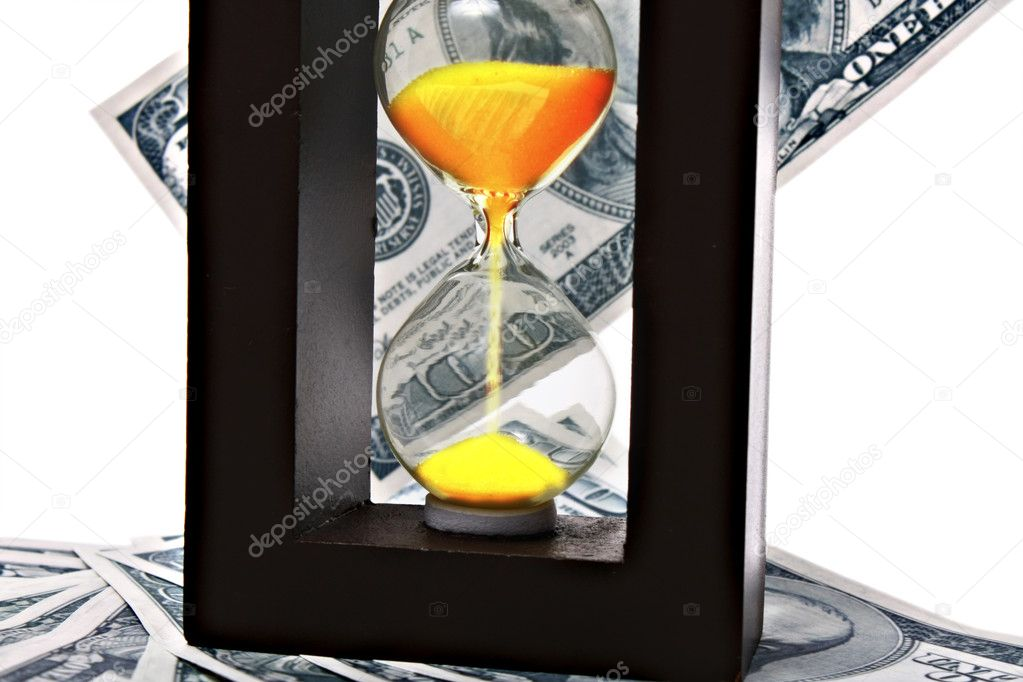 Sand clock with gold sand on dollar background  Stock Photo #6778909