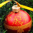 New year decoration on firtree background — Stock Photo