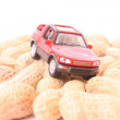 Toy car on peanuts — Stock Photo