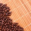 Coffee grains on brown background — Stock Photo