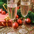 Royalty-Free Stock Photo: Two glasses with champagne and New Year decorations