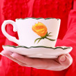 Royalty-Free Stock Photo: A cup of tea on hand