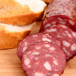 Sausage and bread on wooden surface — Stock Photo #6781941