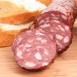 Sausage and bread on wooden surface — Stock Photo #6781945