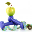 Dumbbells, green apple and measuring tape  isolaeted on white - Stok fotoğraf