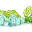 Multicoloured measuring tapes isolated on white — Stock Photo