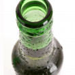 Green glass bottle with beer isolated on white — Stock Photo