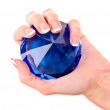 Giant blue diamond in hand isolated on white - Stockfoto