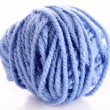 Stock Photo: Blue ball of woollen red thread isolated on white