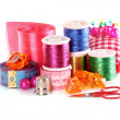 Stock Photo: Coloured bobbins of threads, woolen balls and cushion for pins i
