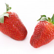 Few strawberries isolated on white - Stock Photo