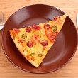 Foto Stock: Tasty Italian pizza on plate